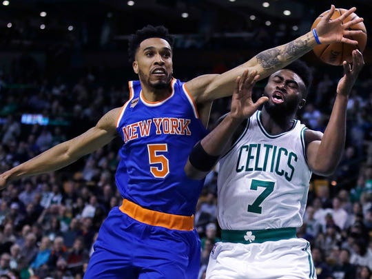 Knicks guard Courtney Lee (5) breaks up a drive to the basket by Boston Celtics forward Jaylen Brown (7) during the game in Boston, Wednesday, Jan. 18, 2017. The Knicks beat the Celtics, 117-106.