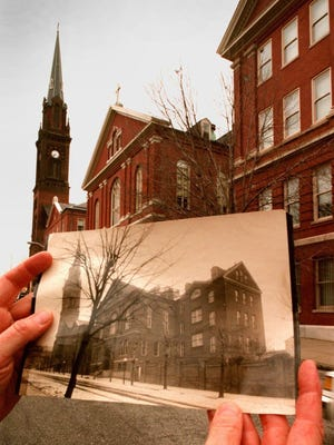 In this Dec. 19, 1996 photo, The Institute of Notre Dame is juxtaposed with a photograph from the early 1900s in Baltimore. Catholic schools have faced tough times for years, but the pace of closures is accelerating dramatically amid economic fallout from the coronavirus pandemic in 2020. The school, founded in 1847, is due to close on June 30, 2020. House Speaker Nancy Pelosi is an alumna.