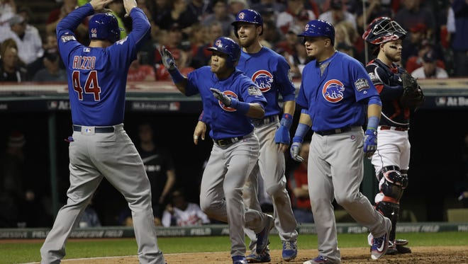 David J. Phillip/AP The Cubs? Addison Russell, center, celebrates with his teammates after hitting a grand slam during the third inning of Game 6 of the World Series against the Indians Tuesday in Cleveland. Chicago Cubs' Addison Russell is congratulated after hitting a grand slam during the third inning of Game 6 of the Major League Baseball World Series against the Cleveland Indians Tuesday, Nov. 1, 2016, in Cleveland. (AP Photo/David J. Phillip)
