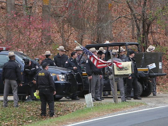 New York state police gather at the entrance of Windswept Farm on Titicus Rpad in North Salem as they investigate the murder of Lois Colley Nov 10, 2015.