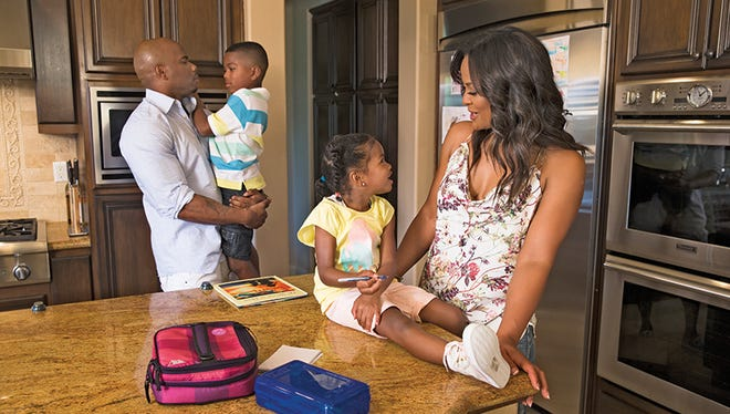 Laila Ali poses with her husband Curtis Conway and her children Sydney, 4, and Curtis Jr, 6,at their home in Calabasas, CA.