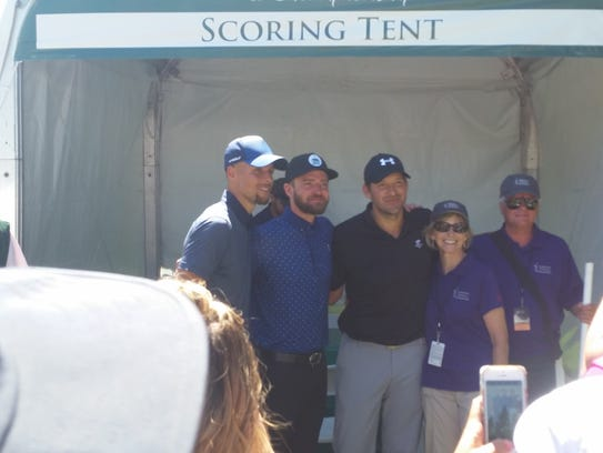 Steph Curry, Justin Timberlake and Tony Romo pose after