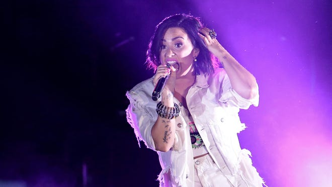 Demi Lovato performs during the All-Star Concert at Paul Brown Stadium on Saturday night.