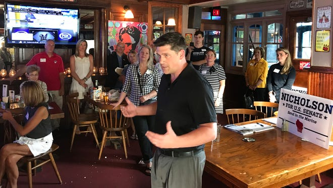Republican U.S. Senate hopeful Kevin Nicholson addresses GOP activists at the Northshore Pints and Politics event at the Silver Spring House in Glendale.