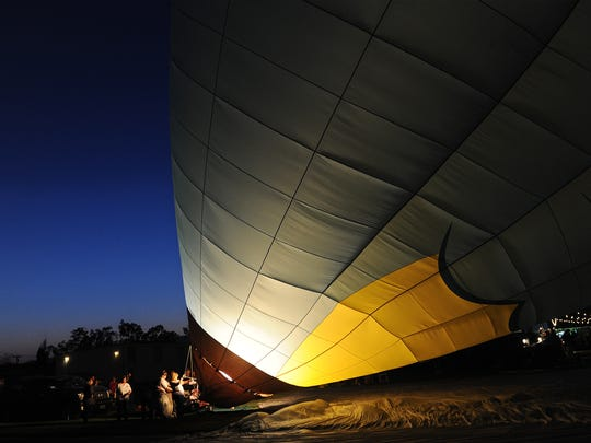 A hot air balloon glows at last year's Starlight Glow at Santa Paula Airport.