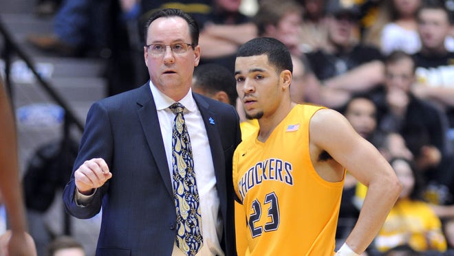 Wichita State Shockers head coach Gregg Marshall talks with guard Fred VanVleet (23) against the Evansville Aces during the first half at Charles Koch Arena. The Shockers won 81-67.