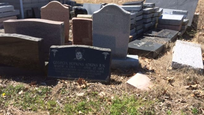Headstones piled near the offices of Galilee Memorial Gardens from March 2015