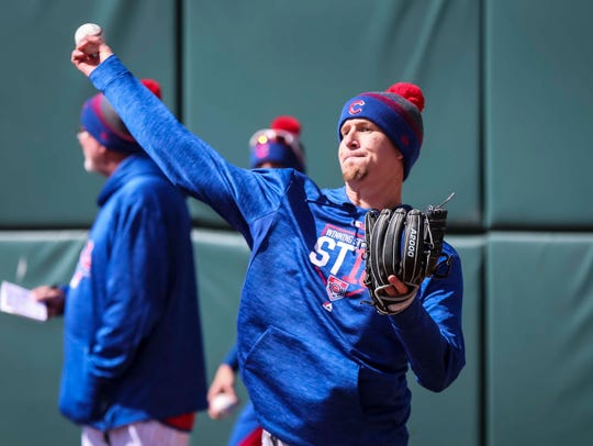Iowa Cubs' pitcher Alec Mills works out during media