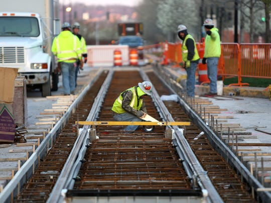 Crews work on installing tracks into Downtown streets.