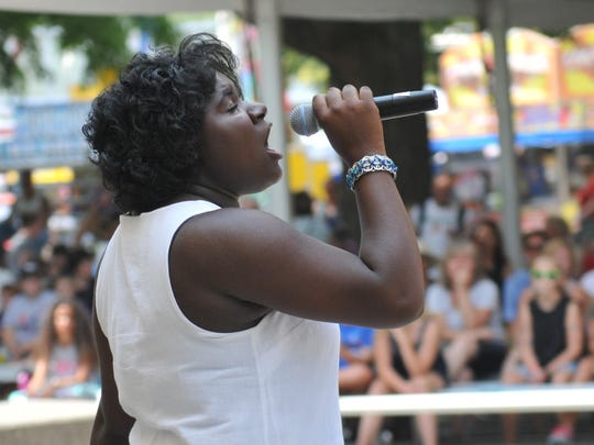Fifteen year old Niyakayla Smith, of Montezuma, performs a vocal solo in the Bill Riley Talent Search at the Iowa State Fair on Aug. 10.
