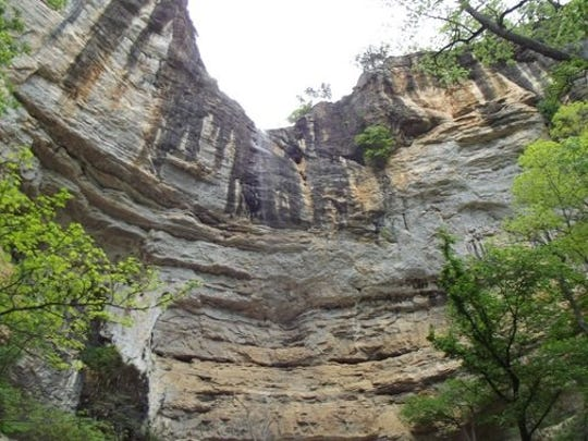 A view of Hemmed In Hollow, where an Ozark man fell Sunday while climbing nearby ledges.