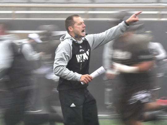 Western Michigan University football coach P. J. Fleck guides his players through practice.