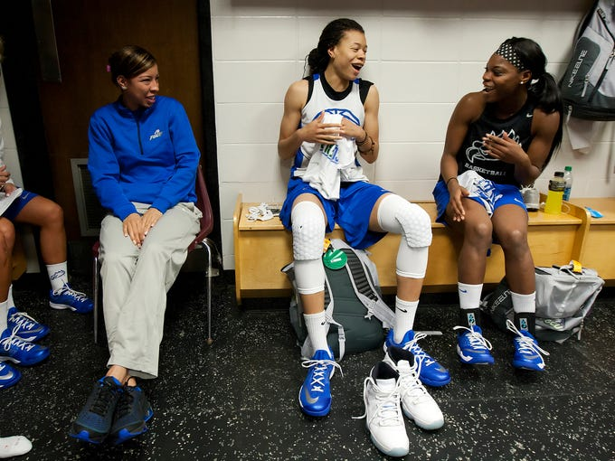 FGCU assistant coach Chelsea Lyles, second from left,