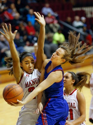 Mercer County's Seygan Robins goes up hard against Manual's Tonysha Curry for the shot in the 44th Annual Girl's Louisville Invitational Tournament.  