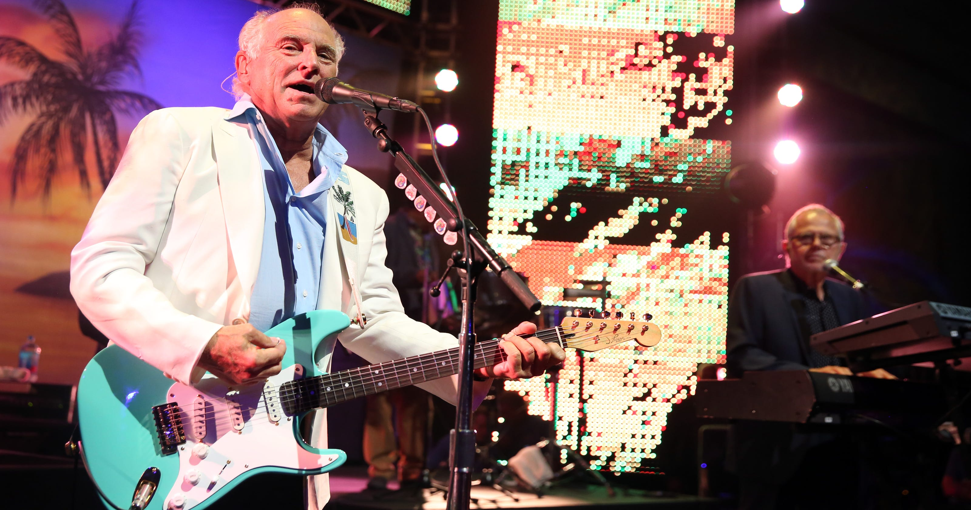 Jimmy Buffett vs  Kenny Chesney: Who is the country/island king?