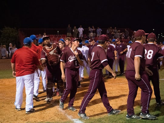 Henderson County shakes hands with Christian County after their season ended with a loss during the Second Region semifinal baseball tournament at Christian County High School in Hopkinsville, Ky., Wednesday evening.