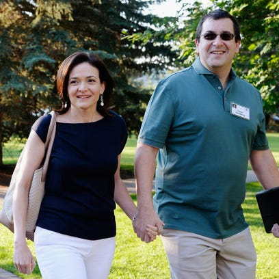 Sheryl Sandberg, COO of Facebook, and her husband David