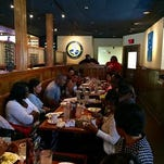 Former U-M linebacker Kenny Demens hosts Mother's Day event at Outback Steakhouse in Southfield.