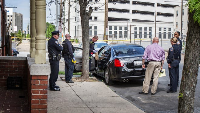 Officials with the Wilmington Police Department investigate a shooting scene at Ninth and Jefferson Streets in Wilmington on Sunday afternoon.
