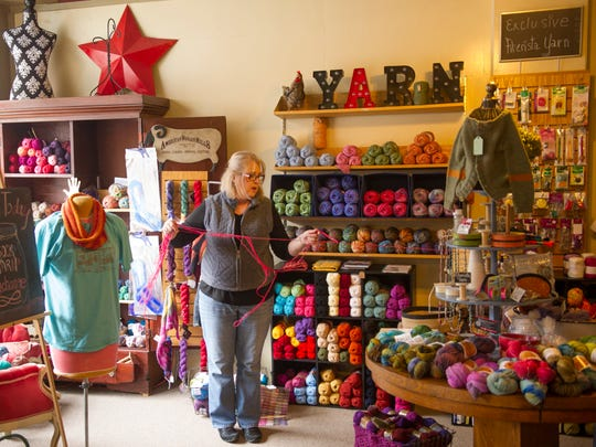 "Sonya Addington untangles her newest yarn creation, ""Be Still My Heart."""