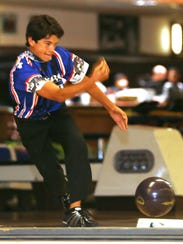 Nick Myers, 14, rolled a ball during a Saturday league