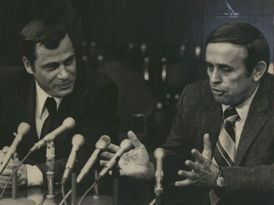 An NCAA scandal in 1976 cost athletic director Burt Smith, right, and football coach Dennis Stolz their jobs.