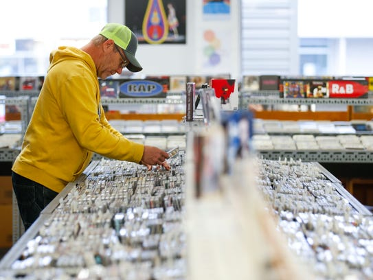 Brent Boudle shops for CDs at CD Warehouse on south