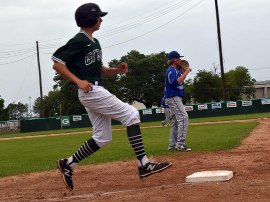 Grace Christian's Luke Boswell (24, left) hits a single against Oak Hill.