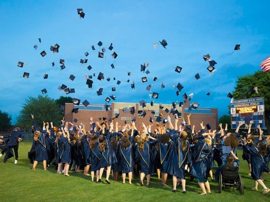 Littlestown students toss their caps during their June 5 commencement.