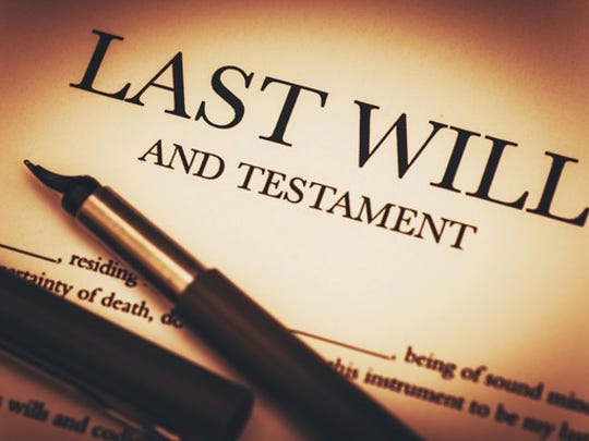 "A paper that reads ""Last will and testament,"" with a pen lying on top of it."
