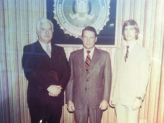 """Former Sheriff Earle """"Buzz"""" McLaughlin, Judge William Webster, and current Sheriff Kevin McLaughlin, shown in 1980."""