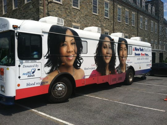 The New York Blood Center bloodmobile parked outside of the Poughkeepsie Journal Building.