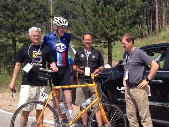 Basketball legend Bill Walton was among the 50,000 fans lining Saturday's USA Pro Challenge bike race.