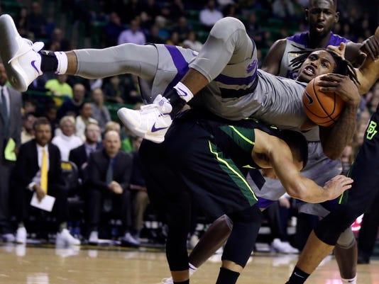 Kansas State guard Cartier Diarra falls on Baylor guard Manu Lecomte while grabbing a rebound in the first half of an NCAA college basketball game, Monday, Jan. 22, 2018, in  /Waco Tribune-Herald via AP)