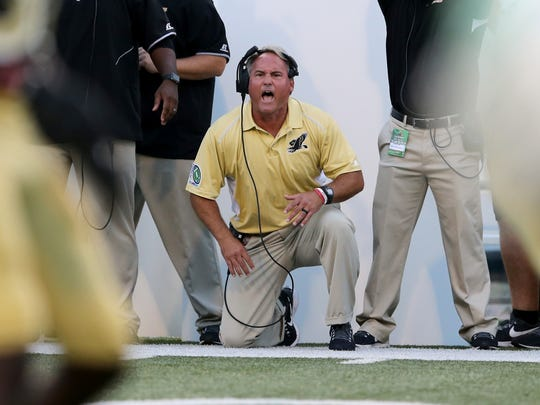 Southern Miss football coach Jay Hopson shouts instructions to his players during last week's loss to North Texas.