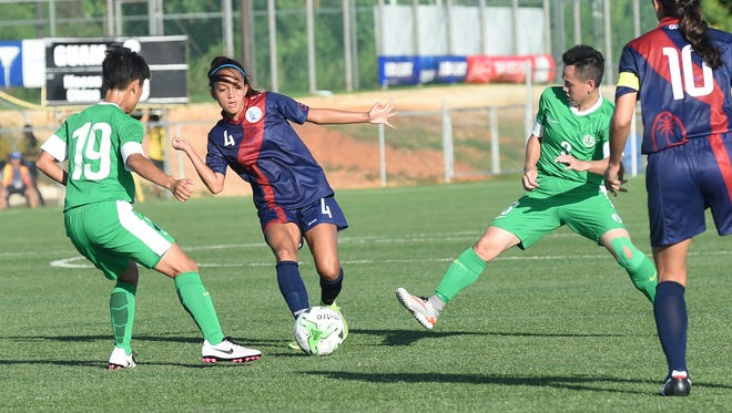 The Masakåda, the Guam women's national soccer team, play Macau-China in an EAFF E-1 Football Championship Round 1 game at the Guam Football Association National Training Center on June 29.