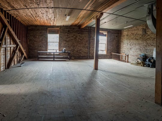 The J.H. Cronin Building in downtown Marshall sits vacant now, but for the past six years Williamston-based developers have envisioned market-rate apartments and boutique hotel suites for the structure's upper floors.