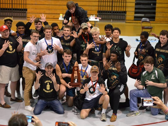 Lincoln's wrestling team captured a ninth straight district title on Friday.