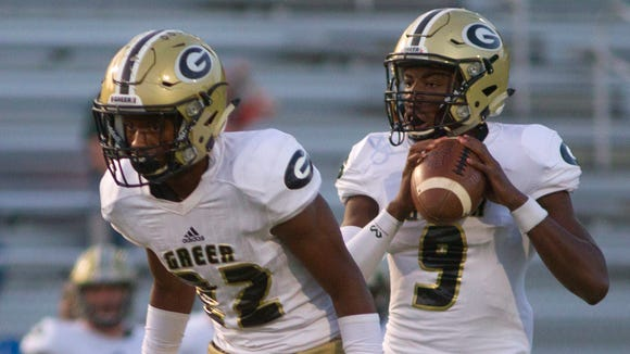 Greer quarterback Trey Houston (9) rushed for 91 yards and passed for 110  in the Yellow Jackets' victory at Daniel.