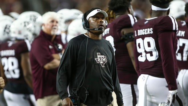 Texas A&M coach Kevin Sumlin stands on the sideline with his team during their game against Alabama.