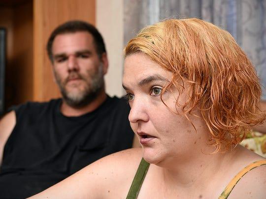 Jocelyn Wood-Rothanburg and her husband Ken talk Wednesday,