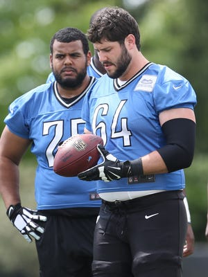 Detroit Lions offensive lineman Larry Worford and Travis Swanson go through drills at training camp on Tuesday, August 4, 2015 at the practice facility in Allen Park MI.