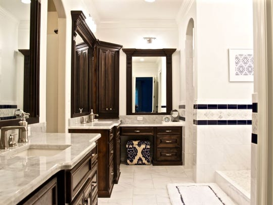 The marble-clad master bath is made for zen with a