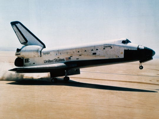 Space shuttle orbiter Columbia touching down at Edwards