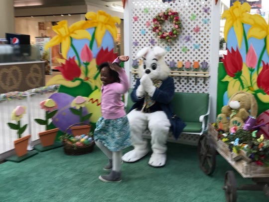 Zechia Mickler, 7, spins after meeting the Easter Bunny.