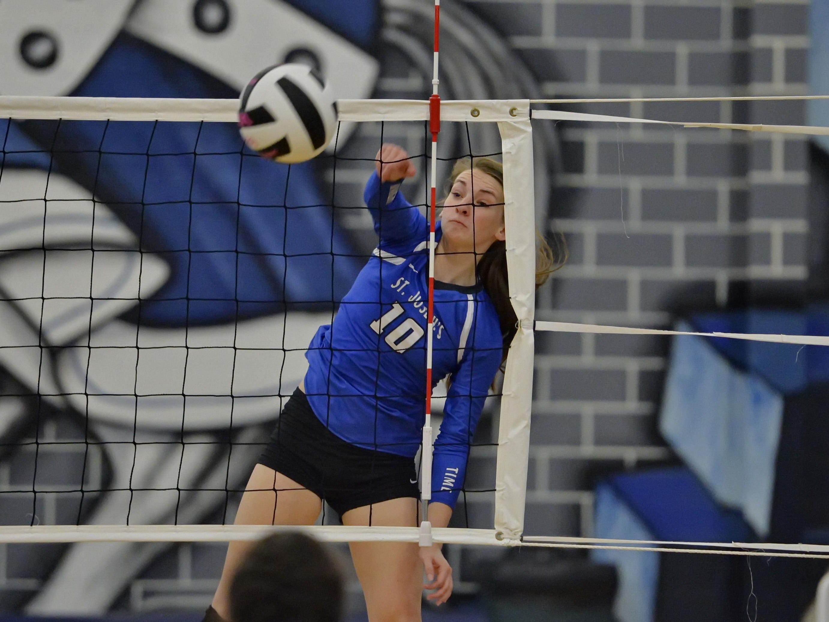St. Joe's Allison Whitten smashes a ball for a point. St. Joe's hosted Ware Shoals in 1rst round volleyball playoffs Wednesday, Oct. 28, 2015.