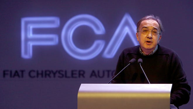 Fiat Chrysler Automobiles CEO Sergio Marchionne talks inside the auditorium during the first of two days of meetings called FCA Investor Day 2014 at the Chrysler World Headquarters in Auburn Hills.
