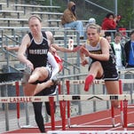 Ursuline Academy alumna Pam Showman, shown here during a race in 2011, was nominated for the NCAA's Woman of the Year.