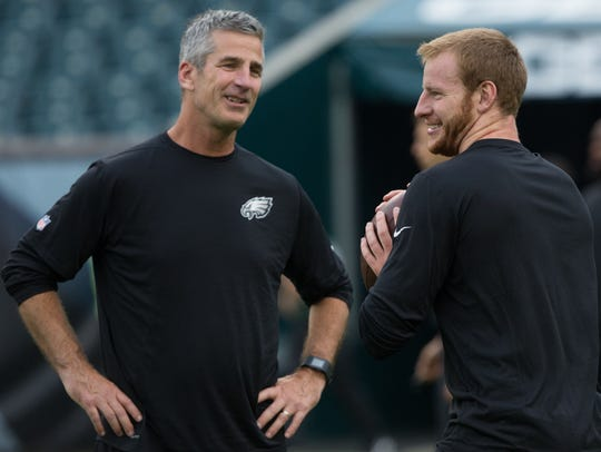 Philadelphia Eagles quarterback Carson Wentz (R) and
