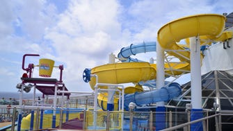 A new water park on Carnival Cruise Line's 2,974-passenger Carnival Glory features two giant water slides.